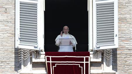 Pope Francis leads his Sunday Angelus prayer in Saint Peter's square at the Vatican